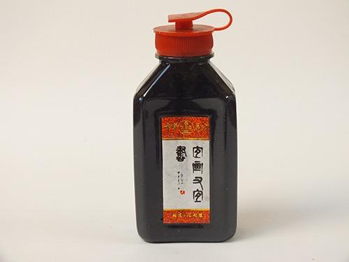Sumi inkt in plastic fles